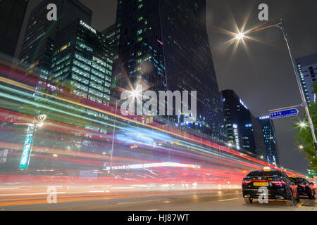 View of light trails, taxis and modern skyscrapers on the Euljiro 2(i)-ga road in the downtown of Seoul, South Korea - Stock Photo