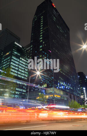 View of cars, light trails and modern skyscrapers on the Euljiro 2(i)-ga road in the downtown of Seoul, South Korea - Stock Photo