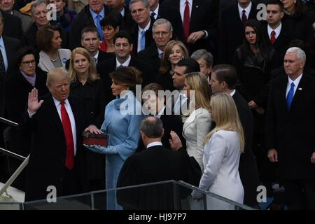 President Donald Trump takes the oath of office from Chief Justice John Roberts as his wife Melania, holds two Bibles, - Stock Photo