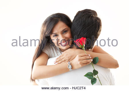 Young couple hugging each other and smiling - Stockfoto