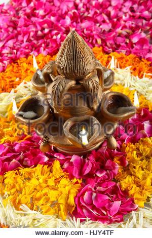 Diya stand with rangoli - Stock Photo
