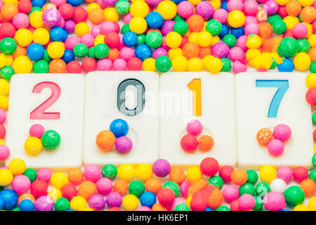 New Year 2017 background with colorful confetti - Stock Photo