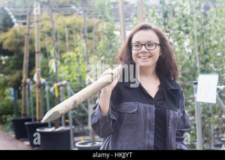 Young woman working in a garden,Freiburg Im Breisgau,Baden-Württemberg,Germany - Stock Photo