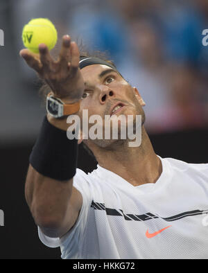 Melbourne, Australia. 29th Jan, 2017. Rafael Nadal serves during the men's singles final between Spain's Rafael - Stock Photo