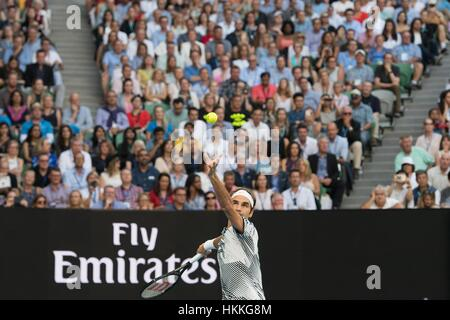 Melbourne, Australia. 29th Jan, 2017. Roger Federer of Switzerland serves the ball during the men's singles final - Stock Photo