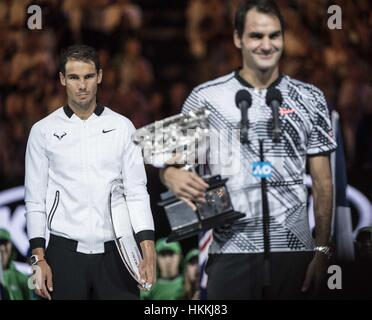Melbourne, Australia. 29th Jan, 2017. Rafael Nadal (L) of Spain reacts during the awarding ceremony for the men's - Stock Photo