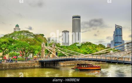 Cavenagh Bridge above the Singapore River, Singapore - Stock Photo