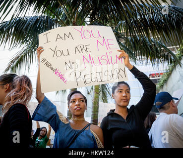 Los Angeles, California, USA. 29th Jan, 2017.  People with signs protesting President Trump's immigration ban at - Stock Photo