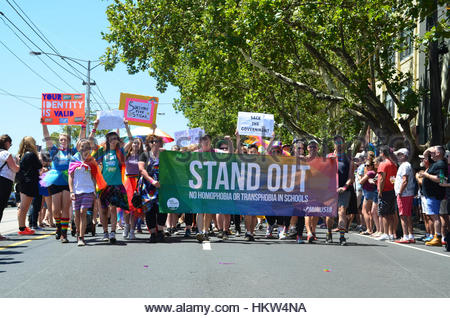 Melbourne, Australia. 29th Jan, 2017. People march behind a banner reading 'Stand out' as over 40,000 come together - Stock Photo