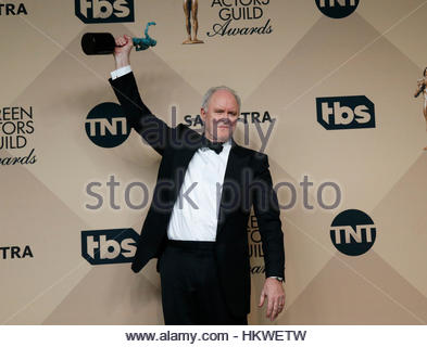 John Lithgow poses with the award he won for Outstanding Performance by a Male Actor in a Drama Series for his role - Stock Photo