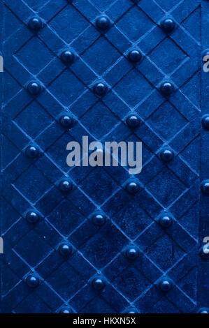 blue metal texture door with rivets - Stock Photo