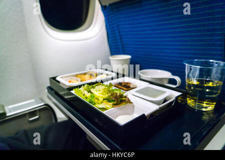 Tray of food on plane - Stock Photo