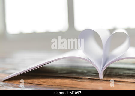 Book with opened pages of shape of heart - Stockfoto