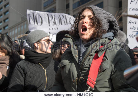 Toronto, Canada. 30th Jan, 2017. Protester yelling against the Travel Ban. Multicultural demonstrators hold an anti - Stock Photo