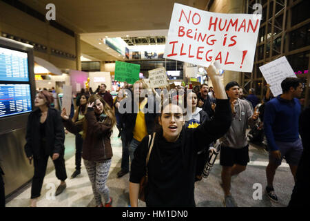 Los Angeles, USA. 29th Jan, 2017. Hundreds march inside the Tom Bradley International Terminal at Los Angeles International - Stock Photo