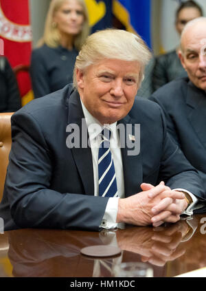 Washington, USA. 31st Jan, 2017. United States President Donald Trump holds a listening session with cyber security - Stock Photo