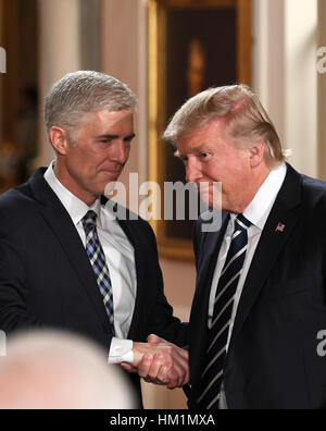 Washington, DC, USA. 31st Jan, 2017. U.S. President Donald Trump (R) shakes hands with Judge Neil Gorsuch after - Stock Photo