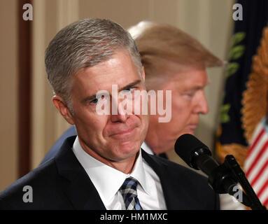 Washington, DC, USA. 31st Jan, 2017. Judge Neil Gorsuch (L) speaks after U.S. President Donald Trump nominated him - Stock Photo