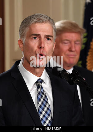 Washington, DC, USA. 31st Jan, 2017. Judge Neil Gorsuch (L) speaks after U.S. President Donald Trump nominated him - Stock Photo