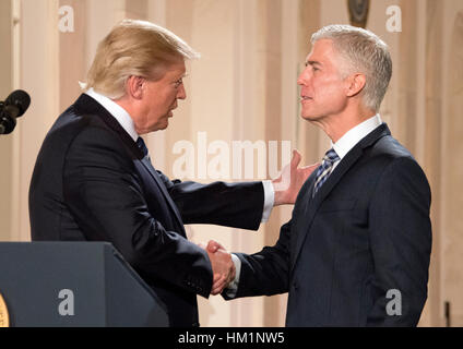 Washington, USA. 31st Jan, 2017. United States President Donald J. Trump (L) announces Neil Gorsuch as his nominee - Stock Photo