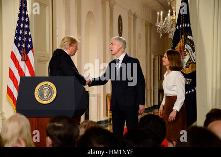 Washington, USA. 31st Jan, 2017. United States President Donald J. Trump (L) announces Neil Gorsuch as his nominee - Stock Photo