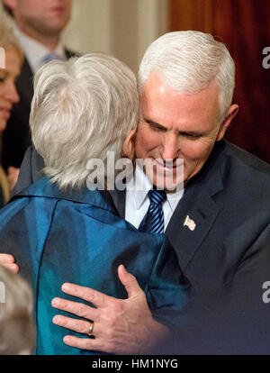 Washington, USA. 31st Jan, 2017. United States Vice President Mike Pence hugs Maureen Scalia, widow of Justice Antonin - Stock Photo