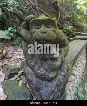 Monkey statue, Sacred Monkey Forest Sanctuary, Ubud, Bali, Indonesia - Stock Photo
