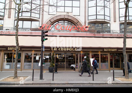 Exterior of La Coupole Brasserie in Montparnasse in the 14th arrondissement of Paris in winter - Stock Photo