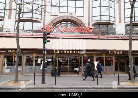 Exterior of La Coupole Brasserie in Montparnasse in the 14th arrondissement of Paris in winter - Stock Photo