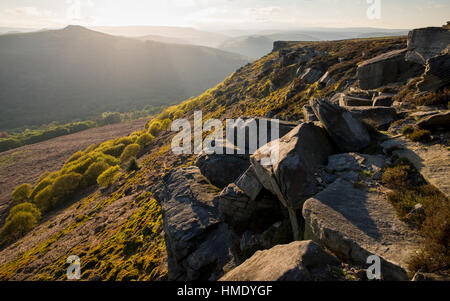 Rocks on Bamford edge in the Peak District park with view to Win hill. A rugged Derbyshire landscape. - Stock Photo
