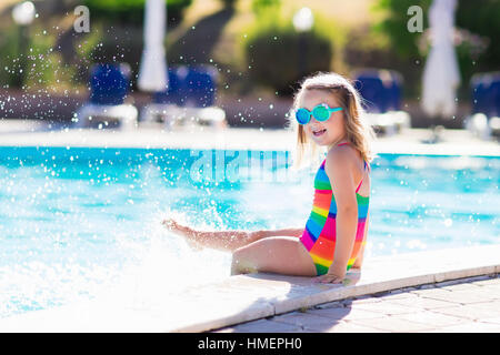 Girl Jumping Into Swimming Pool On Holiday Stock Photo Royalty Free Image 35062864 Alamy