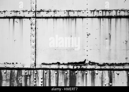 White industrial metal texture with rust and rivets - Stock Photo