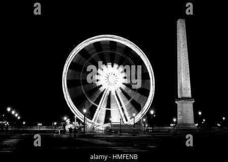Ferris wheel in Paris night scene long exposure - Stock Photo