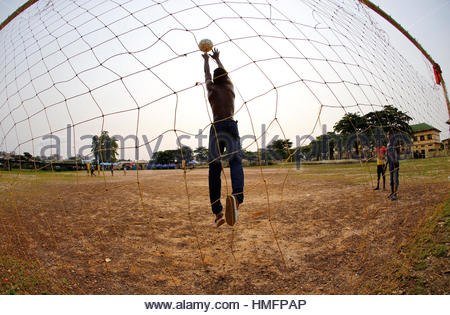 Youths practice their soccer skills at a park ahead of the African Nations Cup soccer final in Libreville, Gabon, - Stock Photo