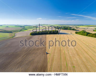 Aerial View Of Tractor Ploughing In Farm Field - Stock Photo
