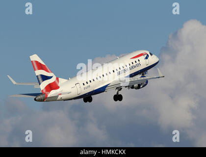 British Airways BA CityFlyer Embraer 170 climbing out after take-off - Stock Photo