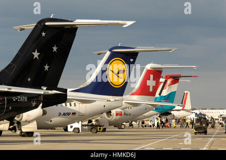tail-fins Titan Airways BAE 146-200 QC Lufthansa Regional BAE 146 RJ-85, Swiss RJ-100 Luxair Bombardier DHC-8 Q400 - Stock Photo