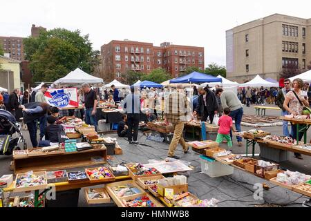 Assorted items for sale at booths, tables, under tents, Brooklyn Flea in October, New York City, USA - Stock Photo