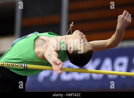 Moscow, Russia. 5th Feb, 2017. Russia's Danil Lysenko competes in the high jump event at the 26th Russian Winter - Stock Photo