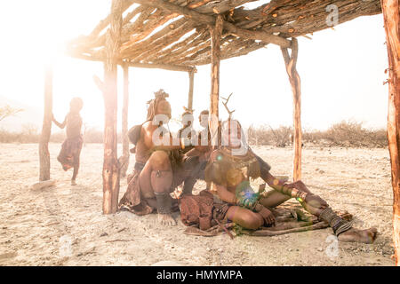 Himba women getting their hair done - Stock Photo