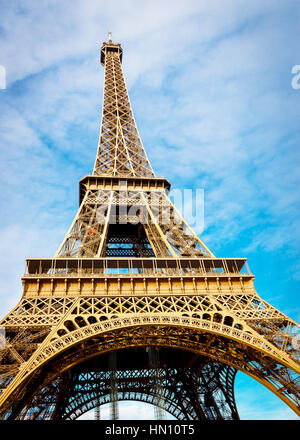 Eiffle tower from the bottom in the day time cloudy - Stock Photo