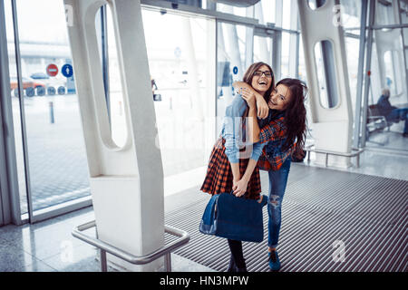 Girls holding hands in a suitcase.Art processing and retouching - Stock Photo