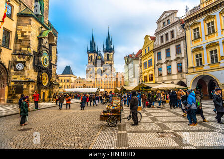 Astronomical clock on Old Town Hall, Tyn Cathedral, Christmas market on the Old Town Square, historic centre, Prague - Stock Photo