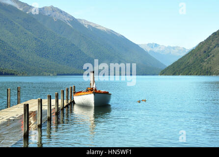 Steam boat and jetty on Lake Rotoiti in the Nelson Lakes District of the South Island, New Zealand. - Stock Photo