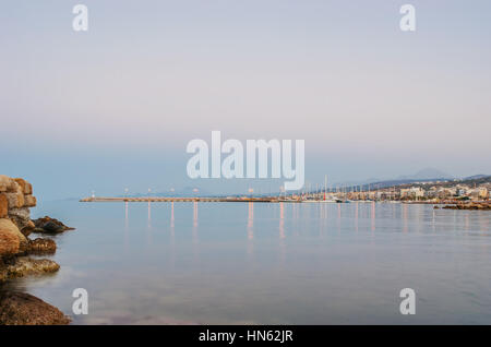 The view on the new port from the breakwater of old lighthouse, Rethymno, Greece - Stock Photo