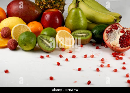 Set of juicy ripe tropical fruits on a white surface - Stock Photo