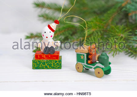 Pine Branches And Wooden Christmas Decorations On A White Background - Stock Photo