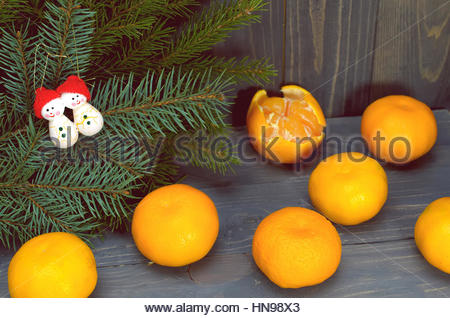 Pine Branches  And Tangerines On A Dark Wood  Background - Stock Photo
