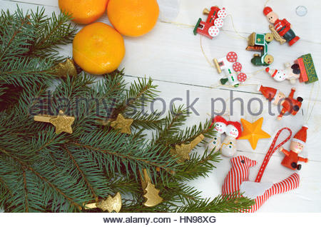 Pine Branches, Christmas Toys And Tangerines On A White Background - Stock Photo