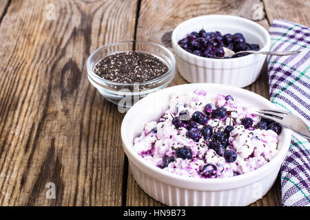 Cottage cheese with berries and chia seeds in white bowl - Stock Photo